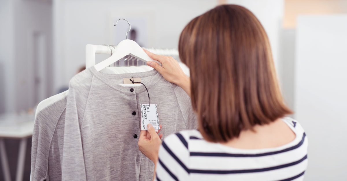 woman looking at a clothing tag design