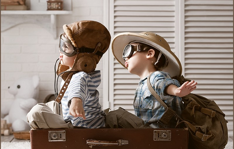 Kids Traveling in Cardboard Airplane Introduce Travel Brochure Examples