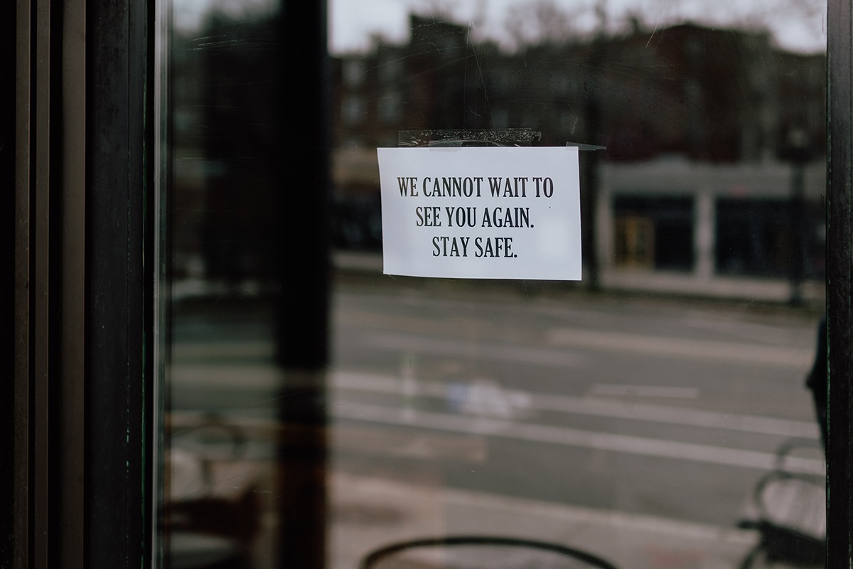 business closed stay safe sign on glass door