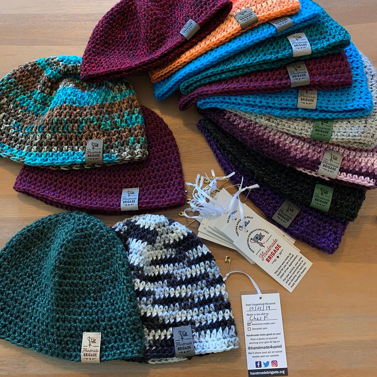 Knitted hats by Handmade Brigade with hang tags